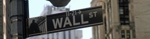 "Green street sign saying ""Wall street"""